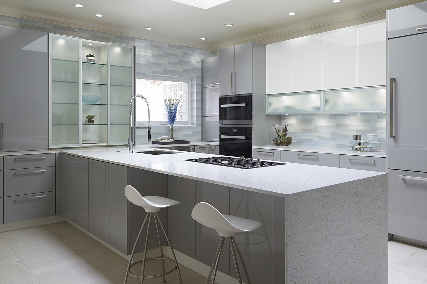 High gloss contemporary cabinets for this Norman remodel with aluminum frosted glass doors and integrated led lighting.