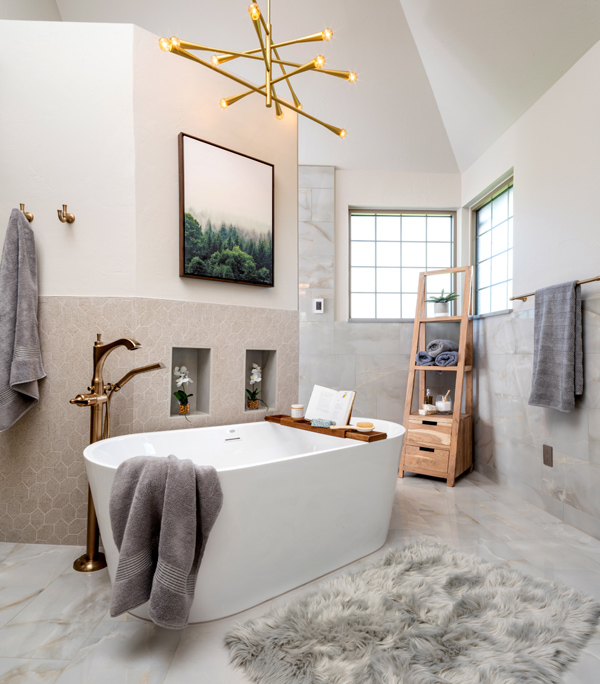 Freestanding tub in front of new walk-in shower wall.