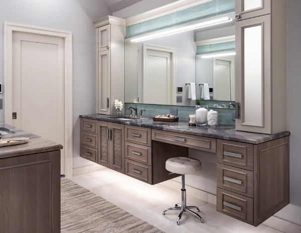 Floating vanity with integrated LED lighting and quartzite tops